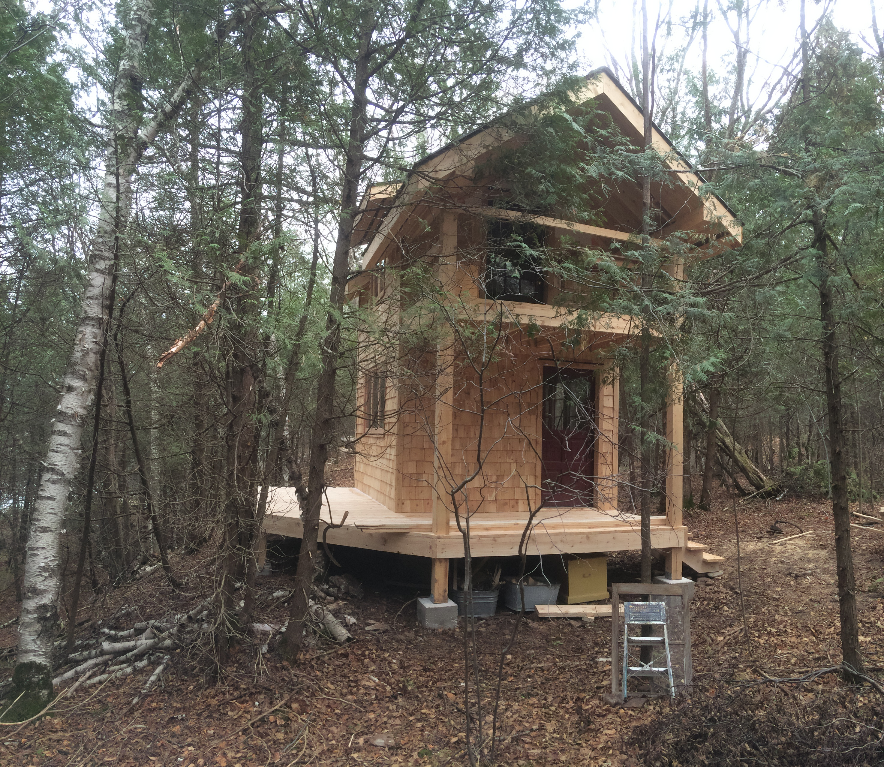 Front of 2 story tiny home in the woods